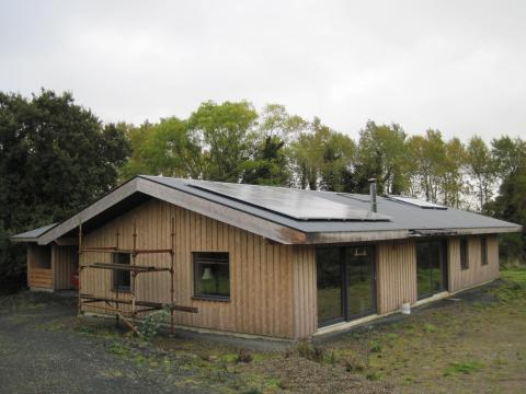 solar hot water, solar PV, wood burning boiler stove, HRV, triple glazed alu-clad windows and airtightness membrane